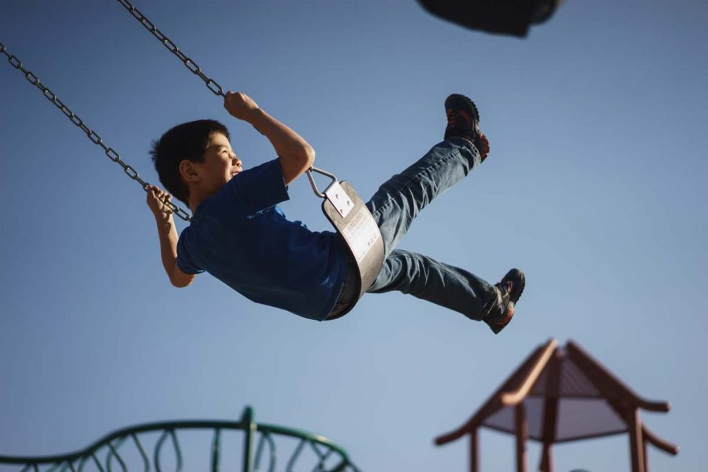 Boy on swings - Digital wellness and physical health