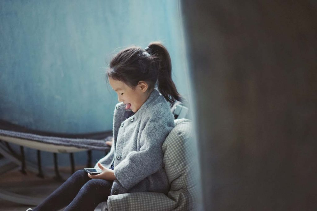 Girl using smartphone - Internet safety