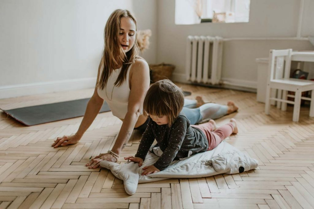 Mom and daughter doing yoga - Digital wellness and health